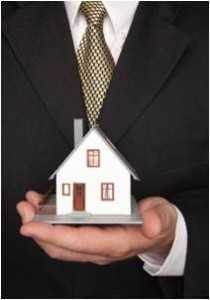Businessman or attorney holding a home