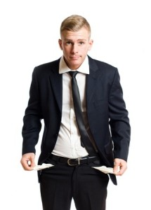 Broke businessman with pockets turned inside out